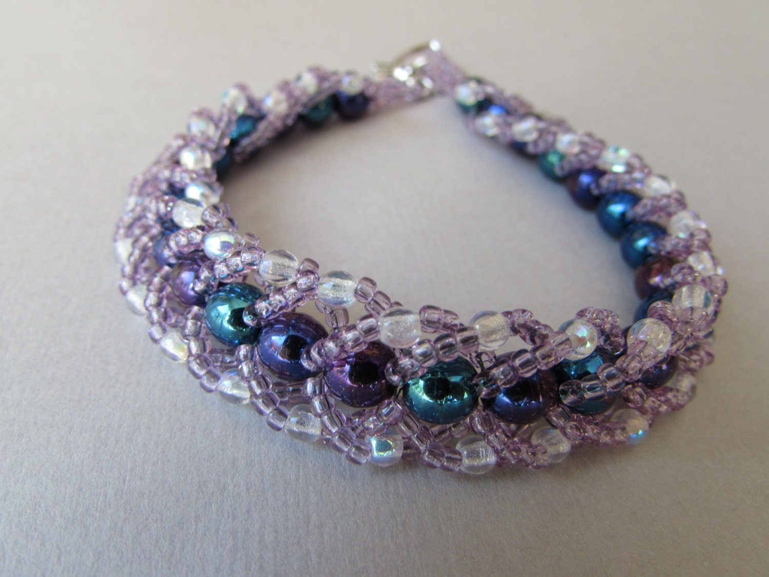 beaded bracelet woven with purple blue and