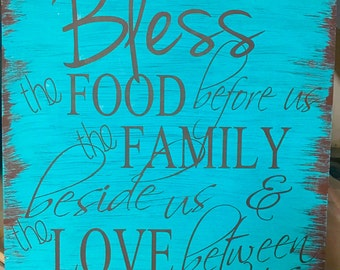 Bless the food before us, the family beside us and the love between us sign for dining room.