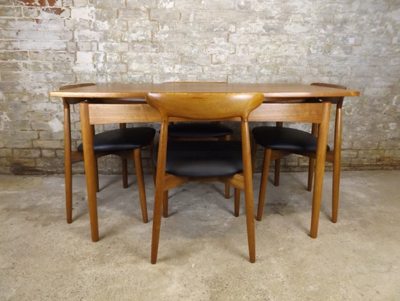 Harry Ostergaard Danish Teak Dining Table and Chairs by  : il570xN835286182nimt from www.etsy.com size 570 x 428 jpeg 58kB