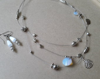 Floating bead, multilayer necklace and earrings set.