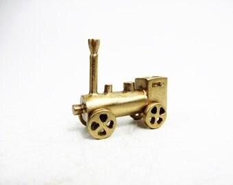 Bronze train miniature, metallic toy