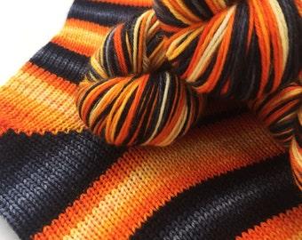 Hand dyed self striping merino sock yarn - Lavastream