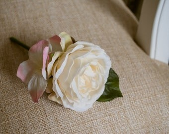Ivory and pink silk wedding buttonhole / boutineer. Made from an artificial rose and eucalyptus.