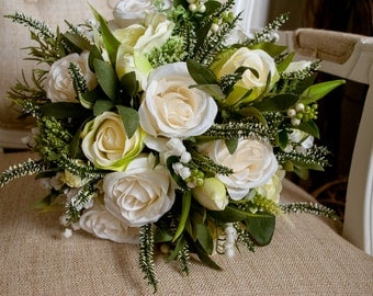 Natural spring silk wedding bouquet. Made with artificial roses, lily of the valley, heather, and tulips.