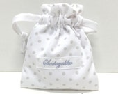 Bag for pacifiers in white and dots