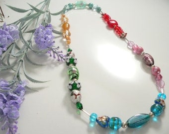 Assorted Glass, Ceramic, Crystals, Freshwater Pearls and Cloisonne Enamel Beads with Sterling Silver Findings.
