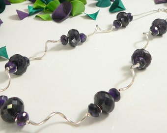Faceted Amethyst Stones with Sterling Silver Findings.