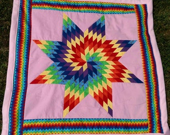 Baby Star Quilt in Twirling Rainbow Colors.