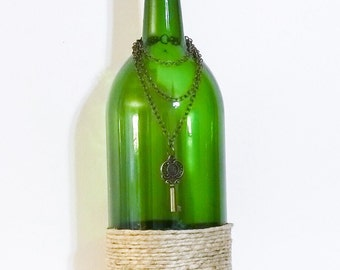 Twine wrapped green wine bottle with chain and key