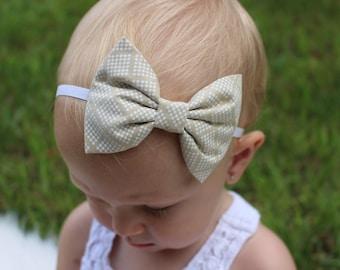 tan and white bow headband