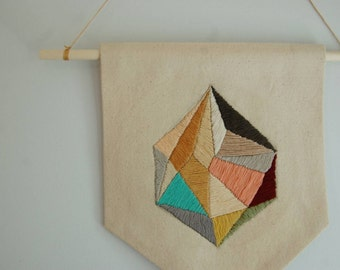 Hand embroidered canvas banner with geometric gem design