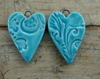 Handmade ceramic heart pendant with a teal glaze