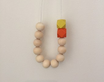 Wooden bead necklace // Round and geometric wooden beads //hand painted // raw beads with orange and yellow geometric beads