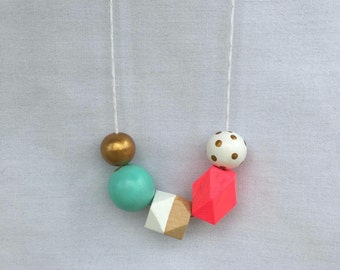 Wooden bead necklace // Geometric and round wooden bead necklace // hot pink, aqua, white and gold // hand painted