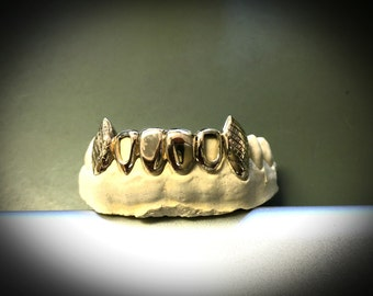 10k gold teeth : 6 bottom with extended fangs and pineapple cuts