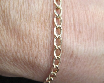 12kt. gold filled  link bracelet from the 1960's, never worn, very pretty, looks like 14kt!