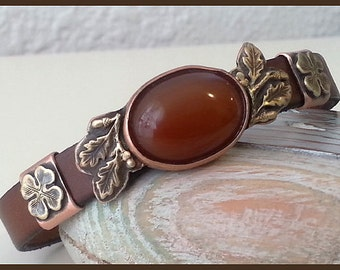 Women brown leather cuff bracelet with carnelian cabochon and author sliders.