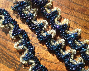 2 pieces 20's beaded trim. 26 inches. Good condition. Genuine vintage