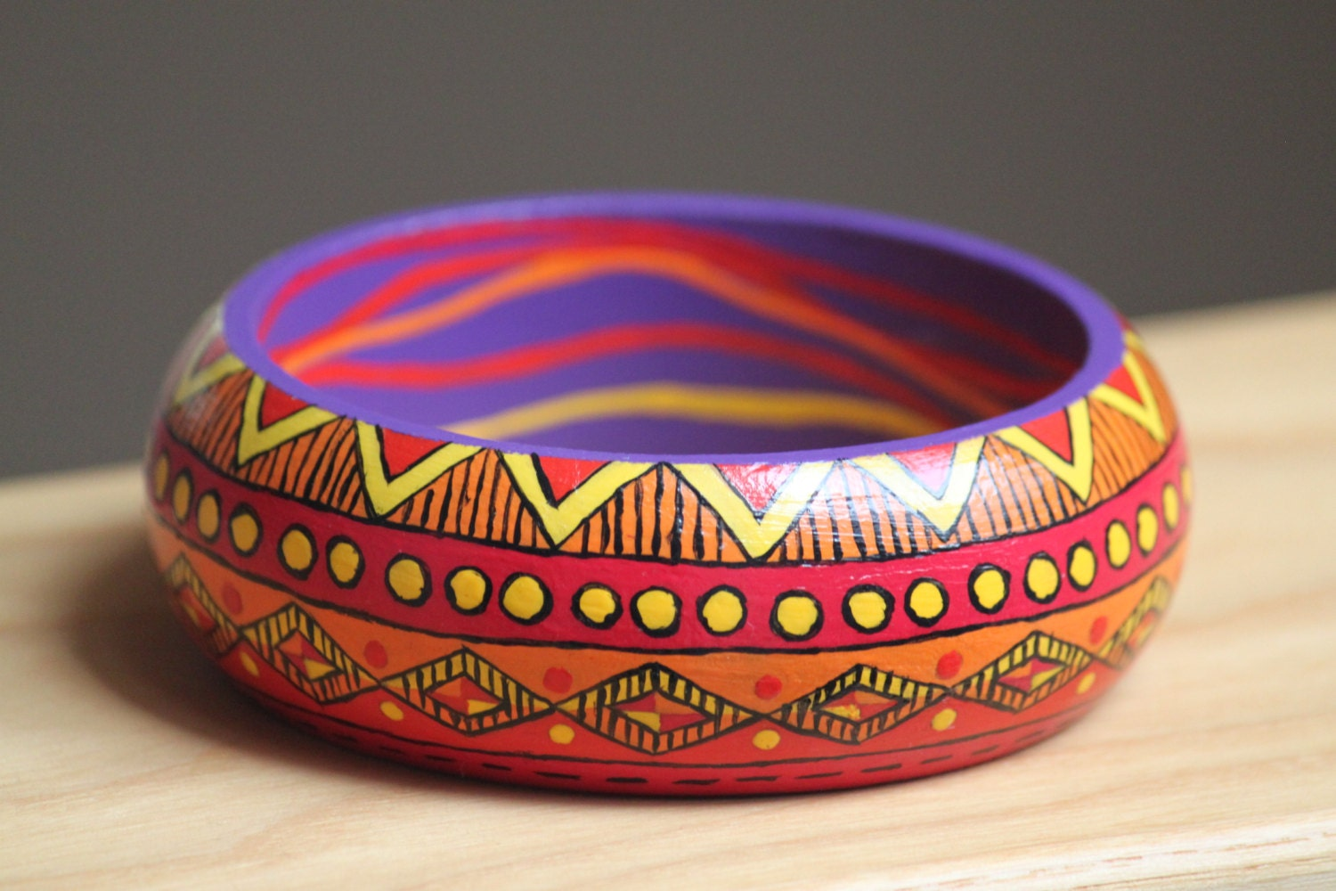 Hand painted wooden bracelet with Aztec pattern. Yellow