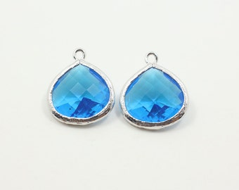G000613P/Capri Blue/Rhodium plated over brass/Pear shape framed faceted glass pendant/16mm x 18.5mm/2pcs