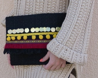 Black pouch in fabric with gold sequins, fringes and tassels