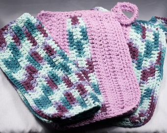 Two pot holders and a matching dish cloth