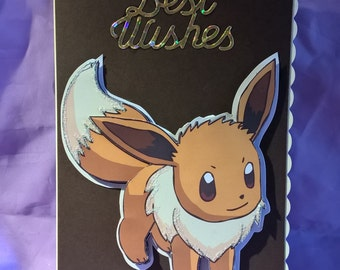 Evee Pokémon birthday card with glitter and gold lettering,a name age or family member can be added if requested when you buy the card