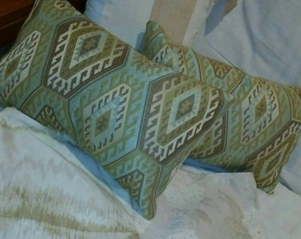 Beautiful nuetral color tapestry pillows.