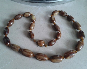Vintage Bakelite Mississippi Mud necklace with button clasp