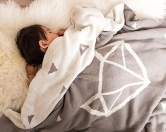 "100% cotton knit reversible blanket/throw ""Nuna"" - features geometric fox design"