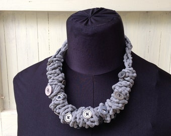 Gray lycra necklace with buttons