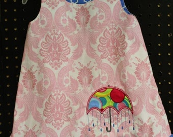 Pink & White Dress with Umbrella Applique and Accenting Blue ruffle