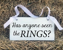 Has anyone seen the Rings Sign, Ring Bearer Sign, Flower Girl Sign, Funny Wedding Sign, Wedding Decor, Rustic Wedding, Wedding Decorations