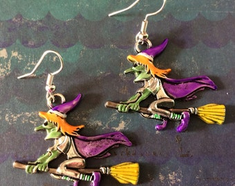 Silver witch earrings.  Witch on broom earrings. Flying witch earrings.  Wicked witch. Halloween jewelry. Handpainted earrings. Quirky cute