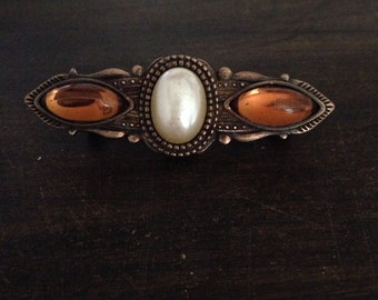 Fake pearl and amber brooch