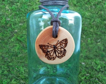 Papillon: White Pine butterfly pendant wood necklace on waxed cotton cord