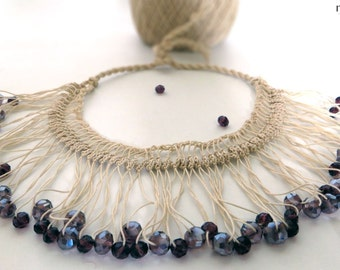 Necklace handmade using crochet with beige thread and shiny purple beads