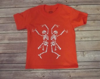 Halloween T-Shirt Dancing Skeletons. 100% Cotton All sizes and color.