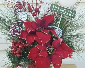Christmas arrangement in vintage santa planter centerpiece