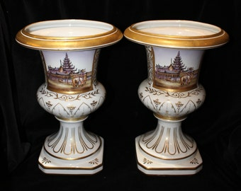 Pair of white and gold urns