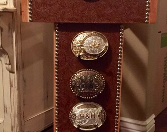 Trophy saddle stand with buckle holders