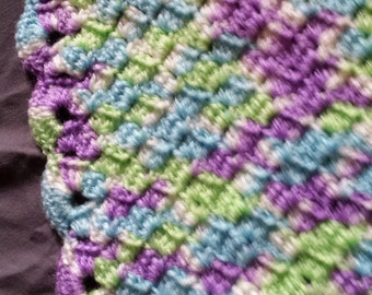 Purple, green, and blue baby blanket