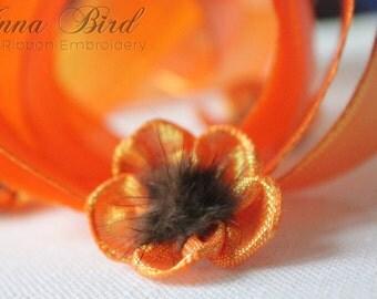 One meter of Tangerine Textured Iridescent Glitter Metallic Wired Ribbon