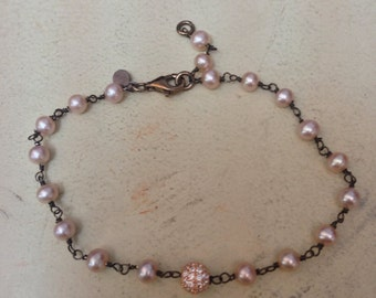 Silver bracelet with pink pearls and Swarovski beads