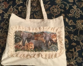 A Shopping Bag With Safari Animals On The Front Of The Bag