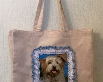 A Hand Decorated Canvas Bag a with a Dog on it, His Face has a 3D effect.