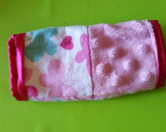Bright pink and butterfly reversible car seat strap covers