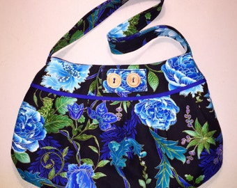 Black with blue and purple floral print pleated purse
