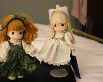 2  Beautiful Precious Moments Dolls, Children of the World.  Both with tags attached. Kari and Shannon.  Great Condition