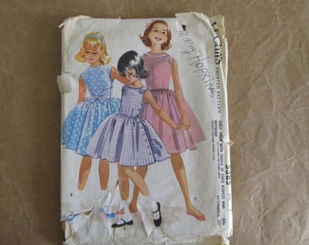 Vintage 1960 McCall's Pattern 5385. Sleeveless Dress with Choice of 3 Bodices and Petticoat, Size 8.